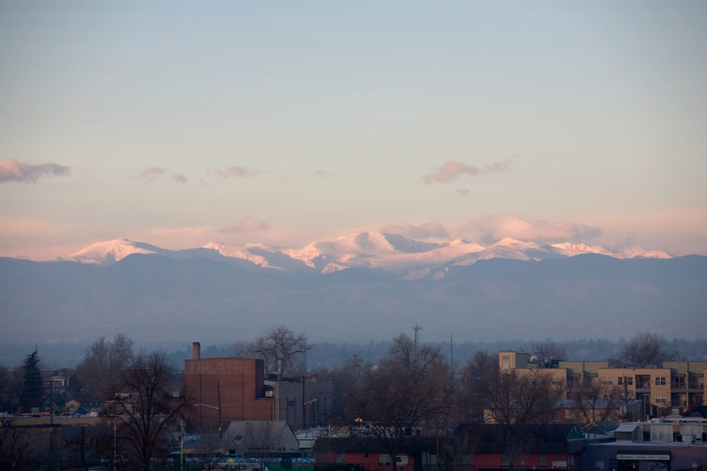 A grainy image of Mount Evans at sunrise.